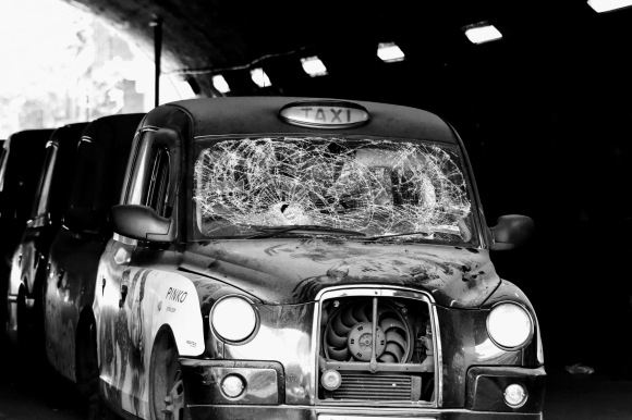 'Taxi' - a London Black Cab in disrepair with its windscreen smashed in