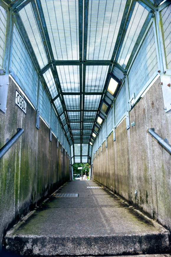 'Bridge O93A' - a view inside the canopied footbrige just outside Epping station