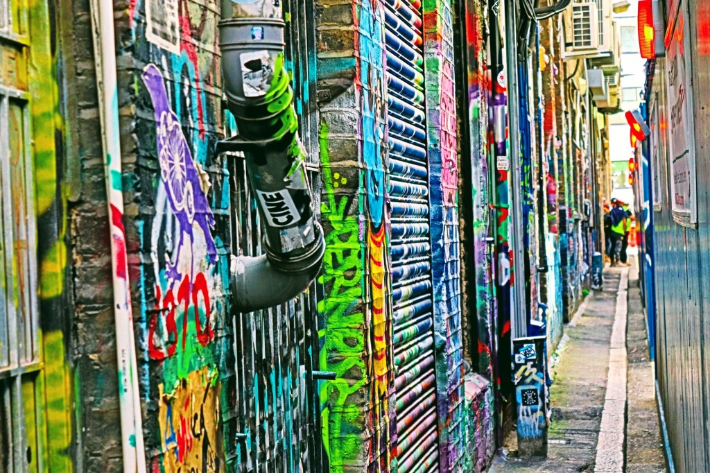 A multi-coloured graffiti alleway