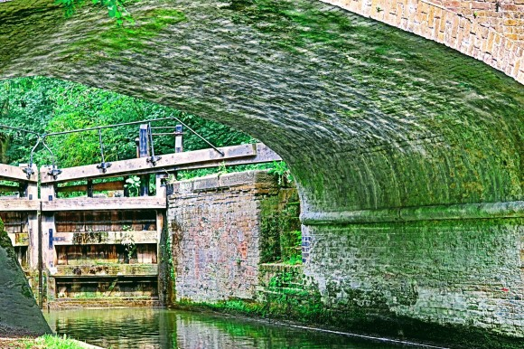 Shimmering water reflection under Cassiobury Bridge along the Grand Union Canal