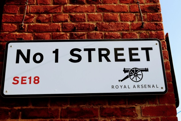 a simple street sign displaying 'No 1 Street' from SE18 in the London area of 'Royal Arsenal'