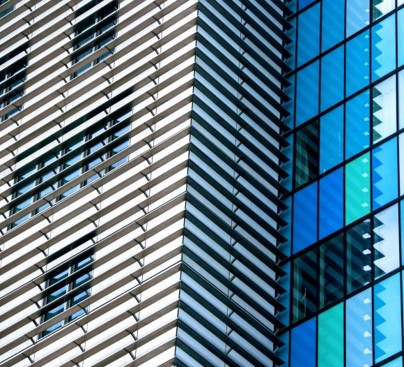 this is a section of the east facade of the Royal London Hospital covered in an array of aerofiols which creates a striking striped black and white covering