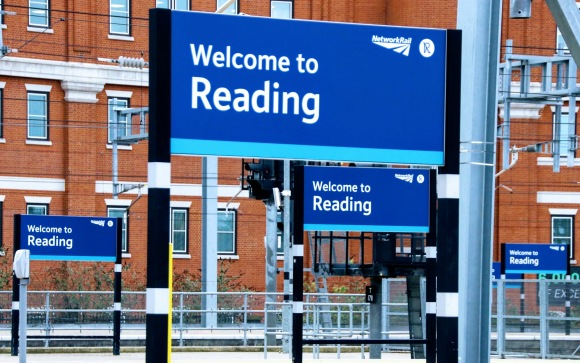 this is a view across Reading station where there are five 'Welcome to Reading' signs