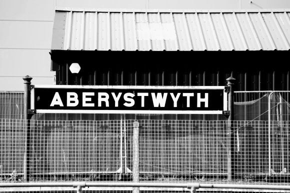 a long shot of Aberystwyth station's name sign