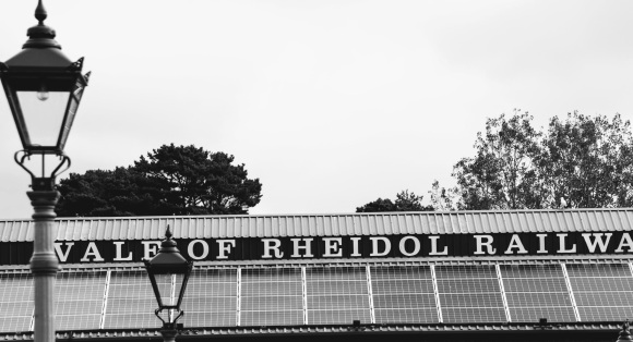 a black and white image of the 'Vale of Rheidol Railway' station's roof