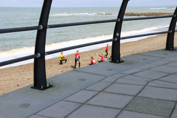members of the Aberystwyth Seal Life Saving Club practicing on beach