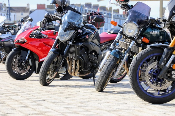 a variety of motorbikes parked up on the promenade at Aberystwyth