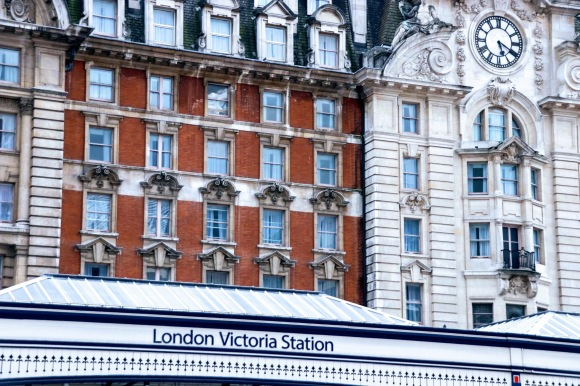 an external view of the station displaying the hotel frontage with the 'London Victoria Station' sign