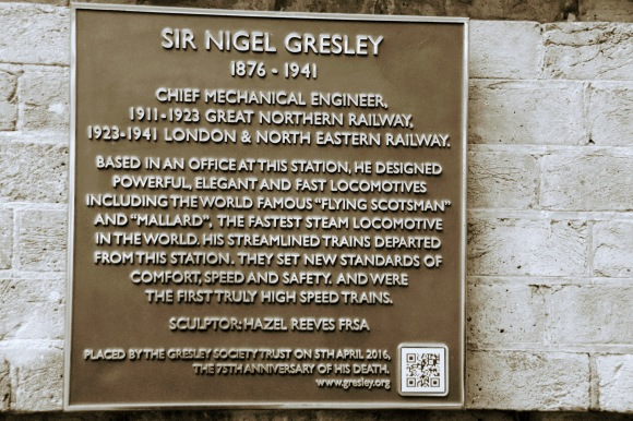 a bronze plaque associated with the statue of Sir Nigel Gresley