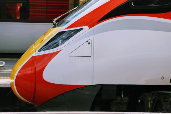 the front of an Azuma train showing off its red and white livery