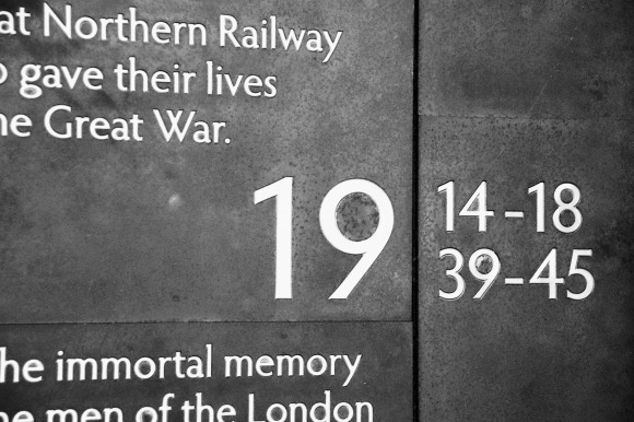 a tight shot of part of the war memorial. This pasrt dipslaying, in themain, 1914-18 and 1939-45 and the words 'Northern Railway' and 'immortal memory'