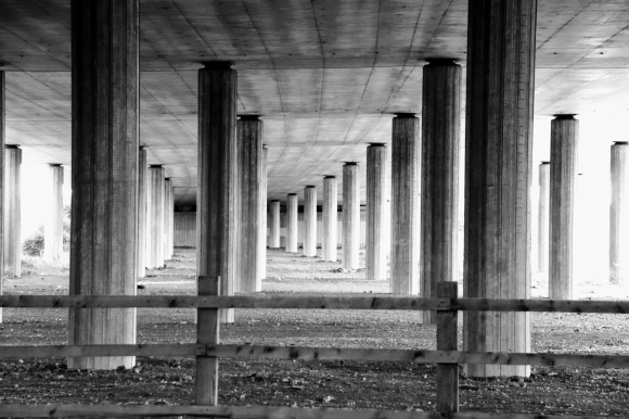 pillar supports holding up the A13 flyover. The shot captures the pillars in formation looking along the length of the flyover