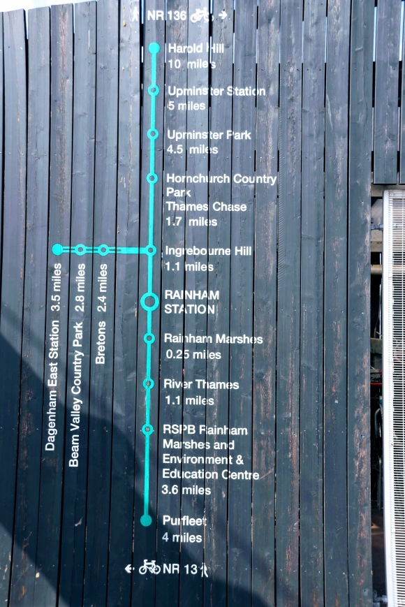 a simple directional map on the side of the station showing Rainham as the centrepiece and distance markers to Dagenham East Station 3.5 miles; Purfleet 4 miles; and Harold Hill 10 miles