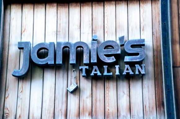 a sign outside the now closed 'Jamie's Italian' restaurant near John Lewis at Westfield. The 'I' of  Italian is hanging by a thread