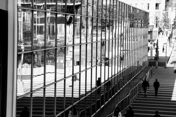 an external side view of the glass panels making up the length of the station concourse. Approximately  5 panels high and 30ish panels long. Just right of shot is the stripped walkway leading up to Celebration Avenue