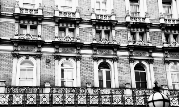 black and white image of the hotel windows above the station entrance. Decorative railings at first floor level above which are three floors of 5 windows. The winows getting smaller and less decorative the higher they are