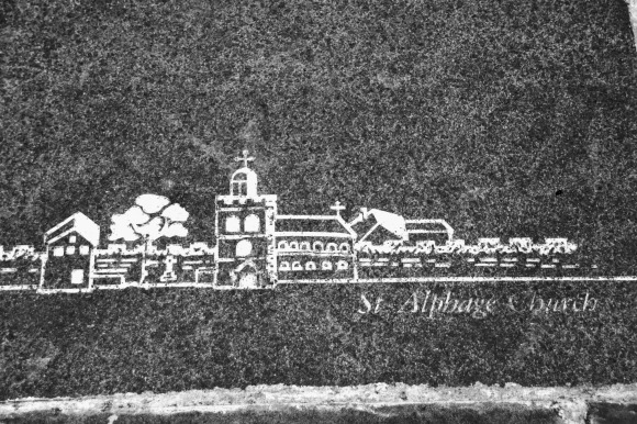 Black & White: a white floor etching of a portrayal of 'St Alphage Church' on a slate grey slab