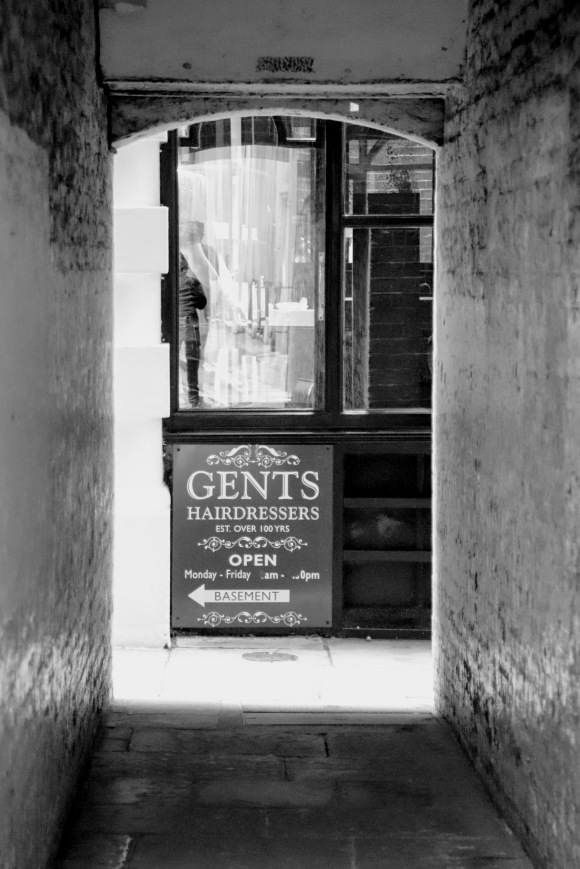Black & White: looking through the tunnel at the end of Tokenhouse Yard at one of the side windows of the Turkish barbers - Restyle