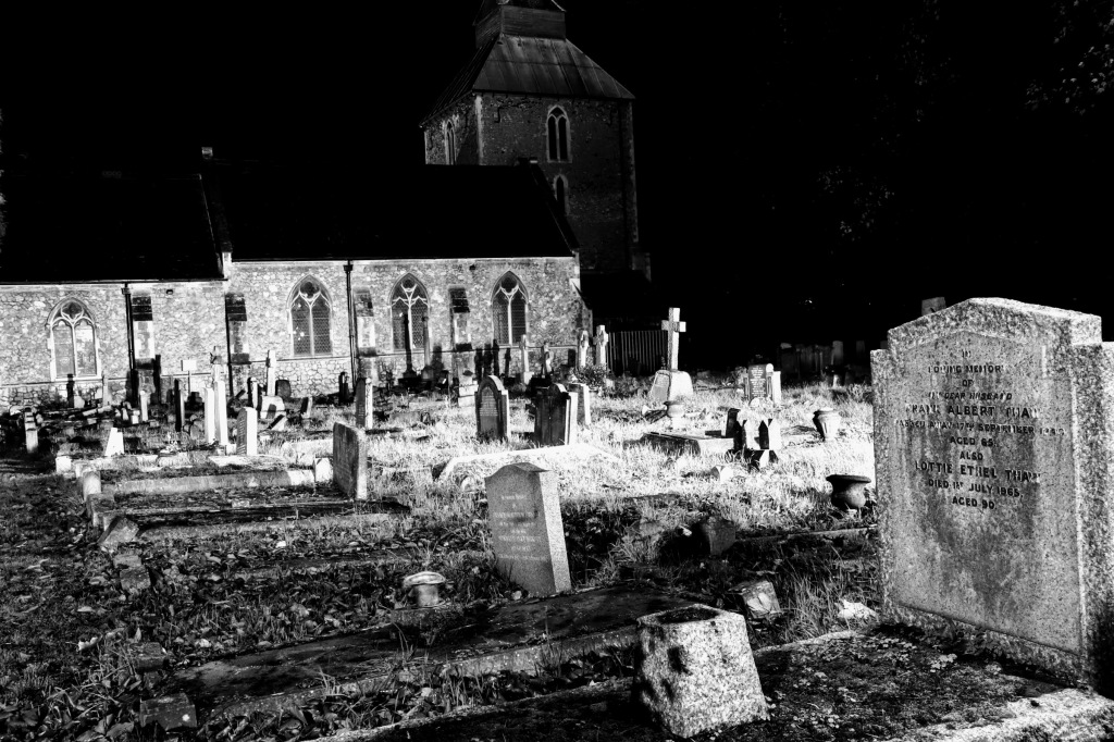 a view over the cemetary in front of the church in crisp black and white